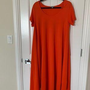 Stunning red orange dress.